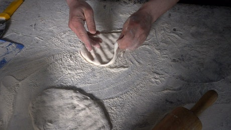 Chef hands preparing dough for Turkish pizza