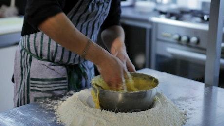 Chef preparing a cake in a restaurant kitchen