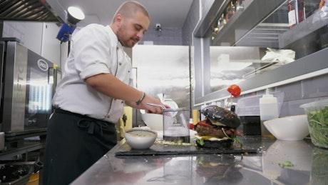 Chef preparing fried potatoes