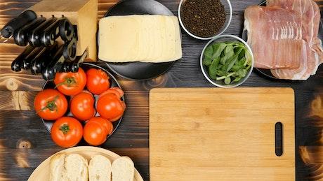 Chef preparing sandwiches on a board, top shot