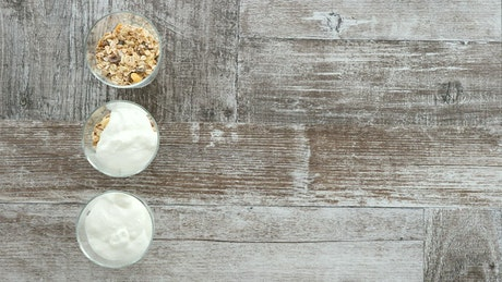 Chef preparing yogurt, top shot