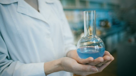 Chemical engineer holding a flask in the laboratory