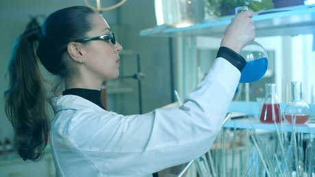 Chemist working in the laboratory with her tablet