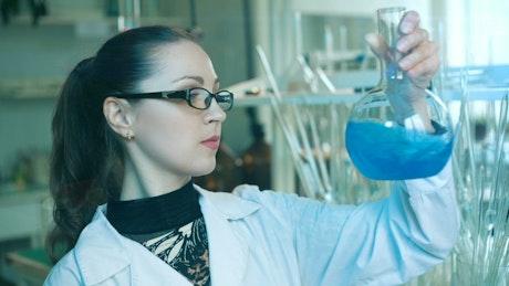 Chemistry shaking a laboratory flask