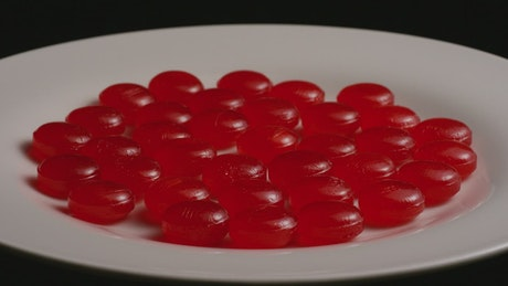 Cherry candies on a slowly rotating plate
