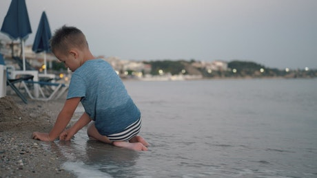 Child spending the evening at the beach