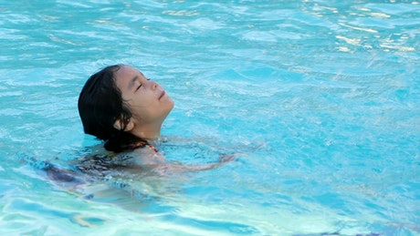 Child swimming in a hotel pool