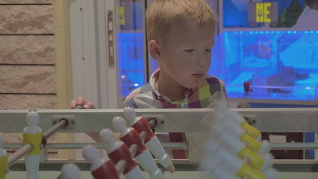 Child watching a game of Table Football