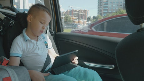 Child watching a movie in the car