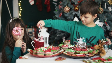 Children celebrating christmas with candies