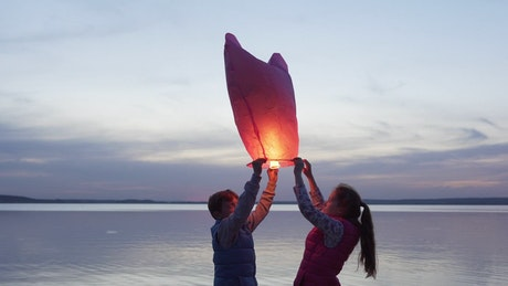 Children launching a lantern