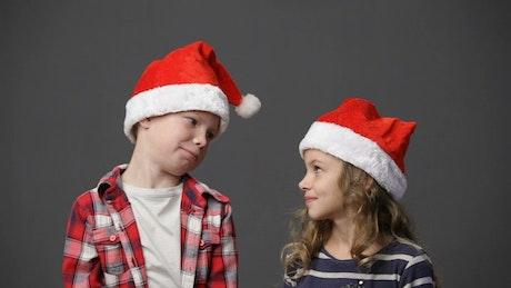 Children looking around in festive hats