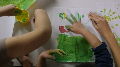 Children painting with their fingers