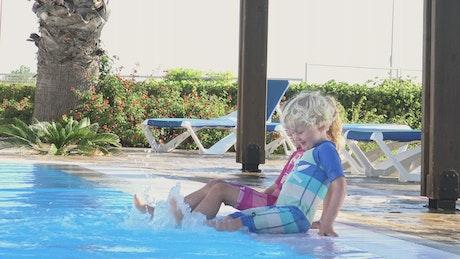 Children splashing in the pool