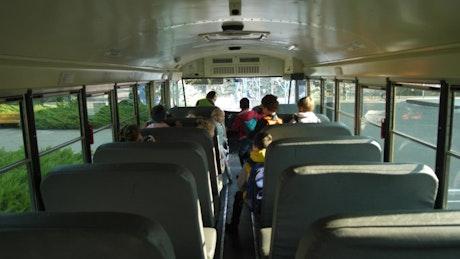 Children walking off of the bus