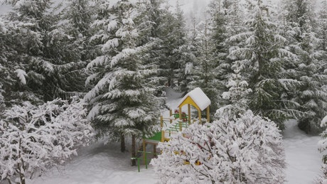 Children's play area in a winter forest