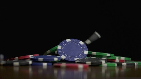 Chips falling down on a Poker table