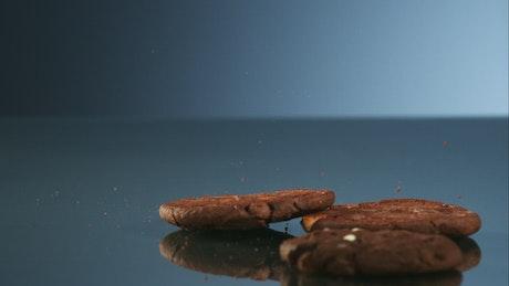 Chocolate cookies falling in bouncing