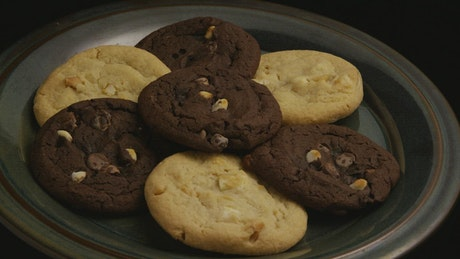 Chocolate cookies on a plate rotating