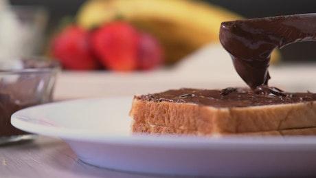 Chocolate or hazelnut cream on white bread