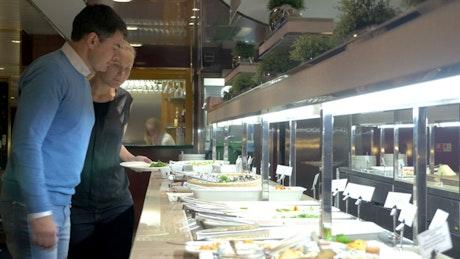 Choosing food at a buffet