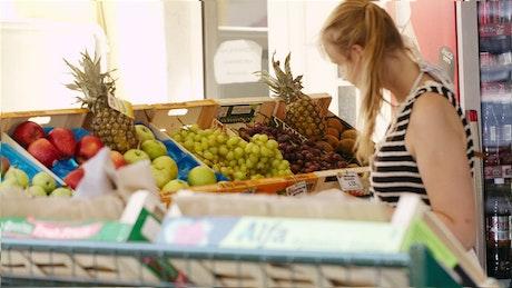 Choosing some fresh fruit