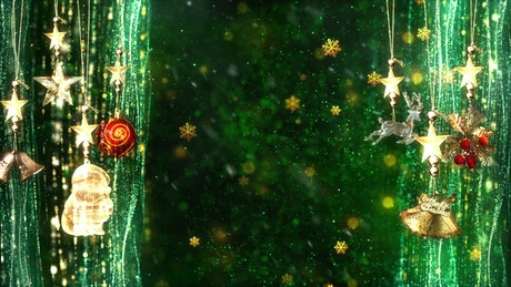 Christmas decorations on green background with golden snowflakes