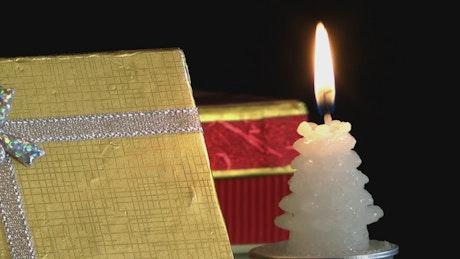Christmas gift box and a candle