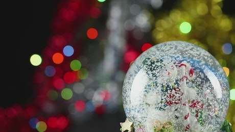 Christmas glass ball with defocused lights behind
