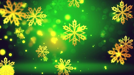 Christmas golden snowflakes on green background
