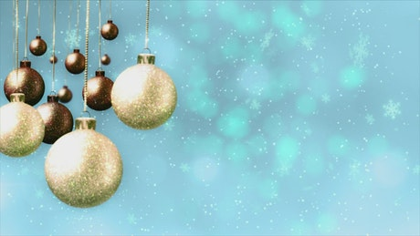 Christmas spheres and snowflakes on blue background