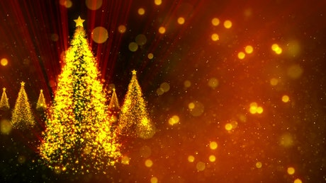 Christmas trees of golden glitter spinning in red background