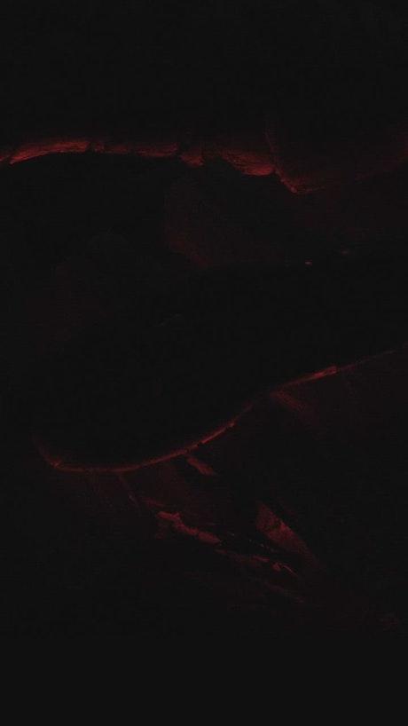 Chunks of coal lit in the dark