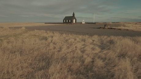 Church by windswept fields