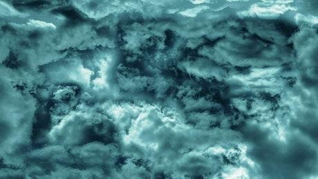 Cinematic flying through dark blue clouds
