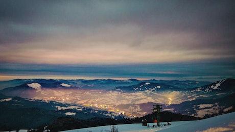 City among mountains at winter night