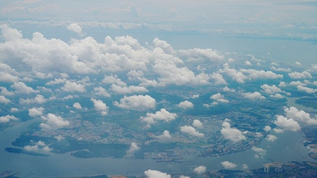 City and clouds from airplane view