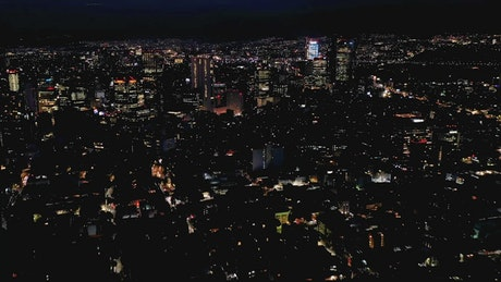 City buildings lit up at night