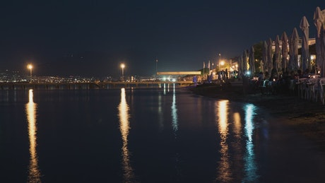 City lights and calm waters at night