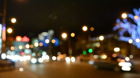 City lights out of focus over a street