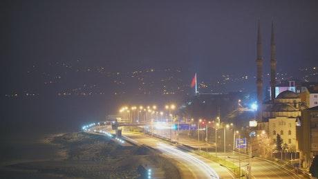 City night lights on a road near the seashore