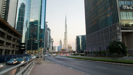 City street traffic and Burj Khalifa in background