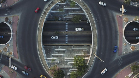 City traffic going around a roundabout from above