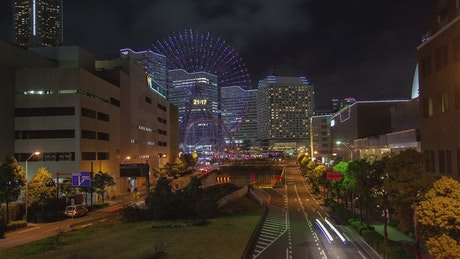 City with a Ferris wheel at night