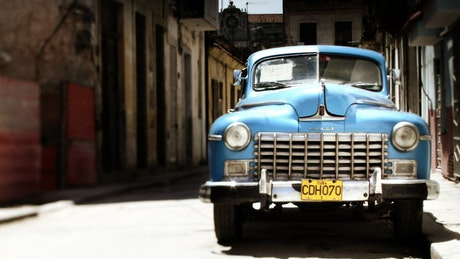 Classic car parked in the street of a town