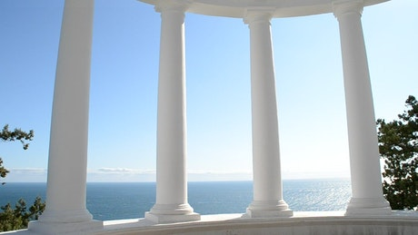 Clean white Columns against the ocean