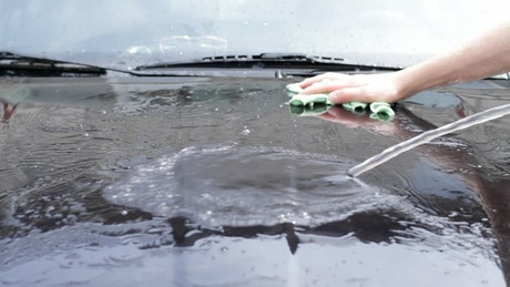 Cleaning a car with water