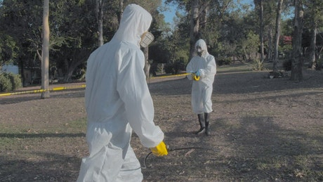 Cleaning staff disinfecting areas of a park