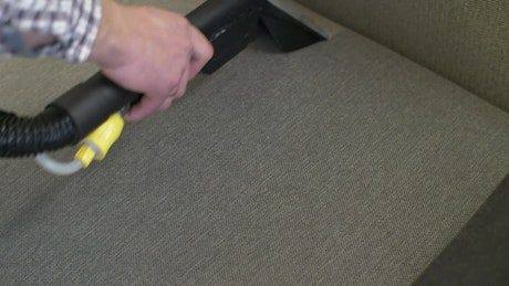 Cleaning the fabric of a sofa