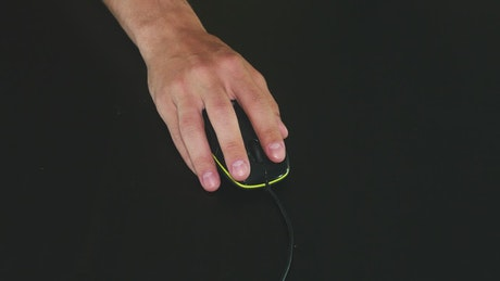 Clicking a mouse against a black background